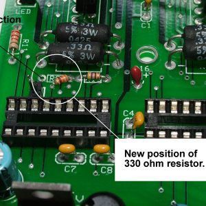 Find the existing resistor shown and snip the wire where it is soldered to the board on the right.