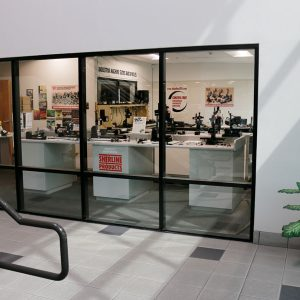 To your right, as you enter the building the showroom can be seen through a glass wall. Displayed are both the standard tool line and the new line of industrial slides and spindles.